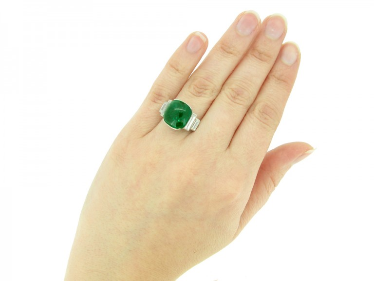 hand veiw Art Deco emerald cabochon and diamond ring, circa 1935.