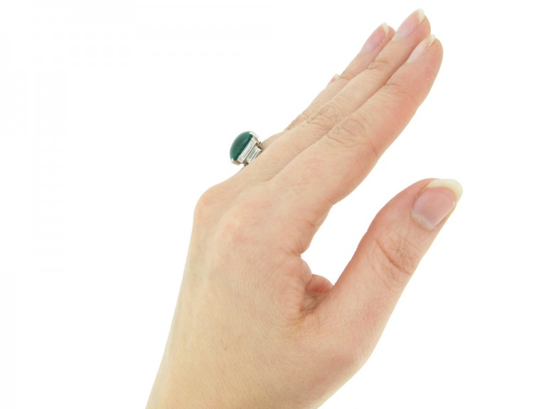 hand view Art Deco emerald cabochon and diamond ring, circa 1935.