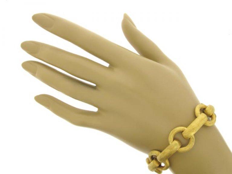 hand view 18 carat gold link bracelet, circa 1960.