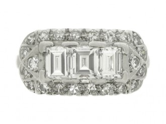 hand view Three stone step cut diamond cluster ring, American, circa 1930.