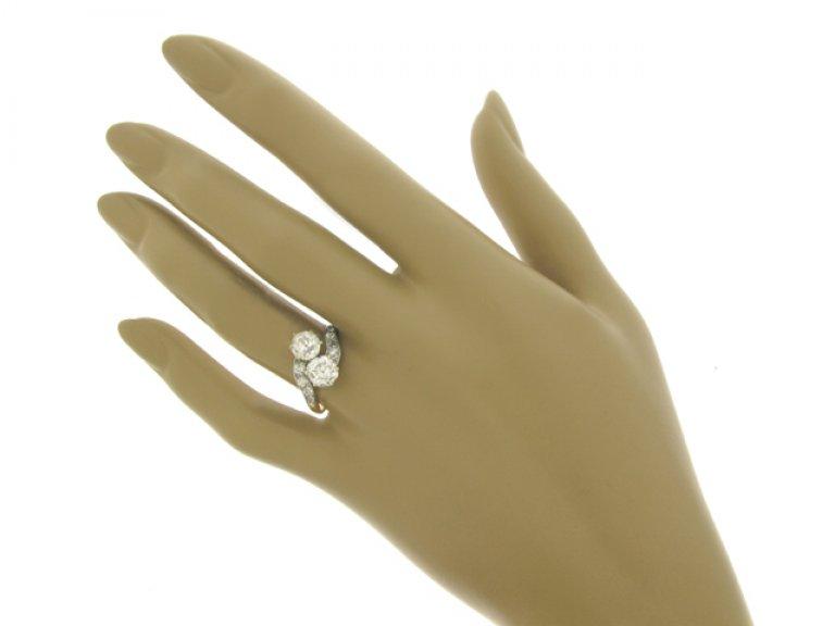hand view Diamond crossover ring, circa 1905.