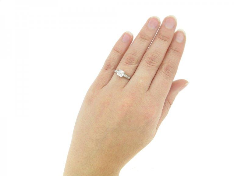 hand view Asscher cut diamond engagement ring wth diamond set shoulders