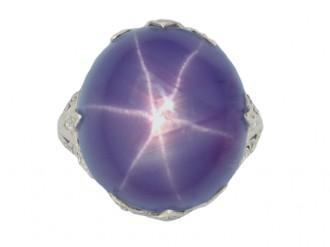 front veiw Mauve star sapphire and diamond cluster ring, circa 1920.