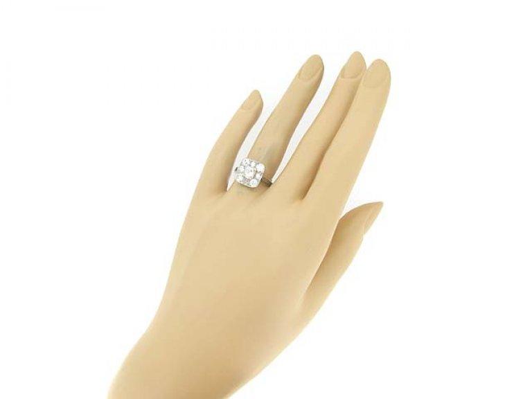 hand view Art Deco diamond coronet cluster ring, circa 1925.
