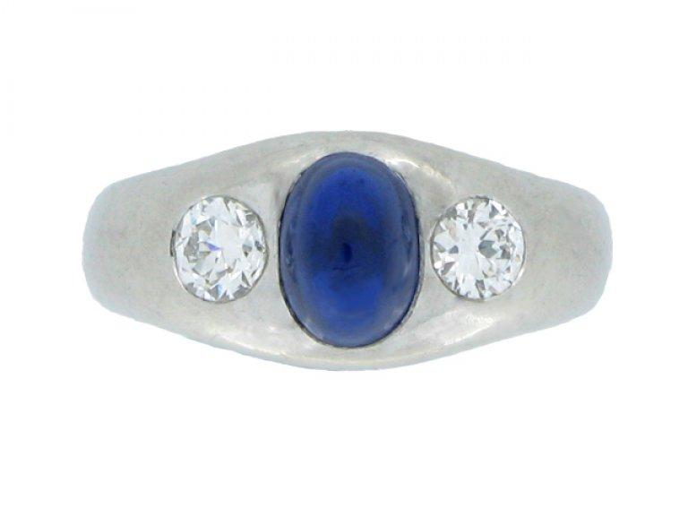 front view Cabochon sapphire and diamond three stone ring, circa 1935.