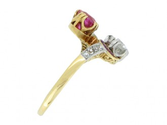 front view Ornate ruby and diamond cross over ring, circa 1910.