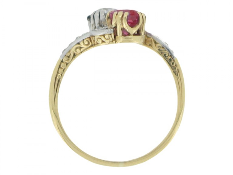 back view Ornate ruby and diamond cross over ring, circa 1910.