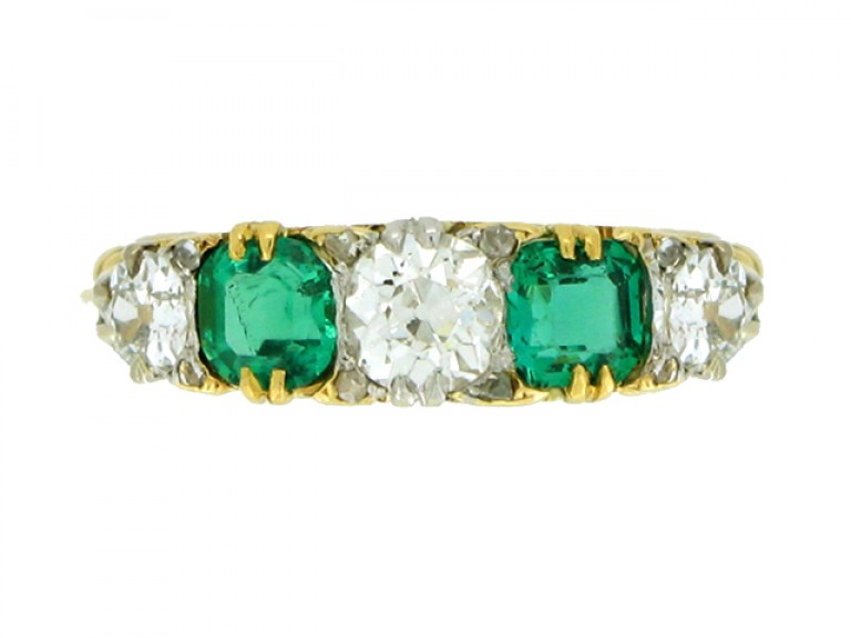 FRONT VIEW Carved emerald and diamond five stone ring, circa 1900.