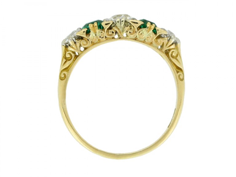 BACK VIEW Carved emerald and diamond five stone ring, circa 1900.