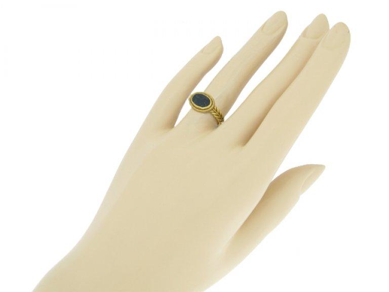 hand view Ancient Roman intaglio ring, circa 1st 3rd century AD.