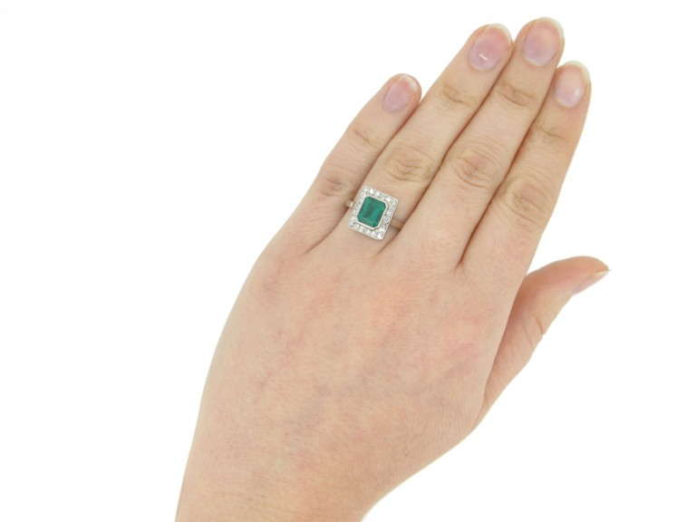 hand view Art Deco Colombian emerald and diamond cluster ring, French, circa 1925.