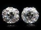 Old mine cushion shape diamond stud earrings, circa 1920.