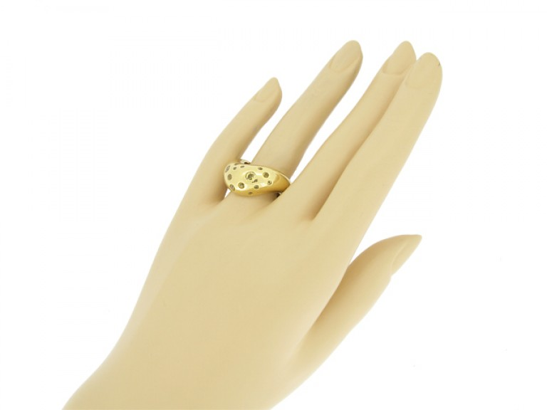 hand view Fred of Paris gold ring set with yellow sapphires, circa 1970.