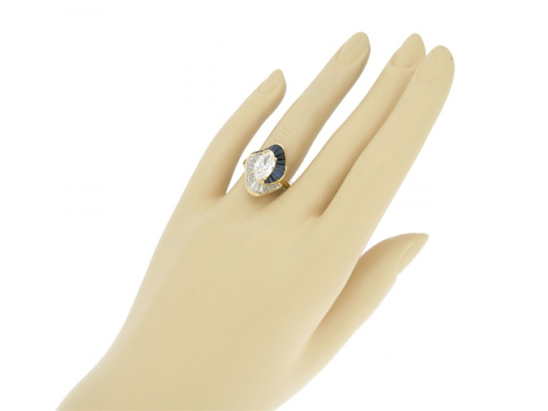 hand view Oscar Heyman Brothers sapphire and diamond ballerina ring, circa 1976.