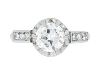 front view Flanked diamond solitaire ring, circa 1930.