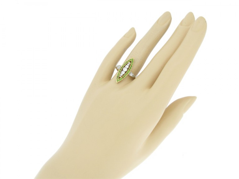 hand view Diamond and demantoid garnet marquise shape ring, circa 1910.