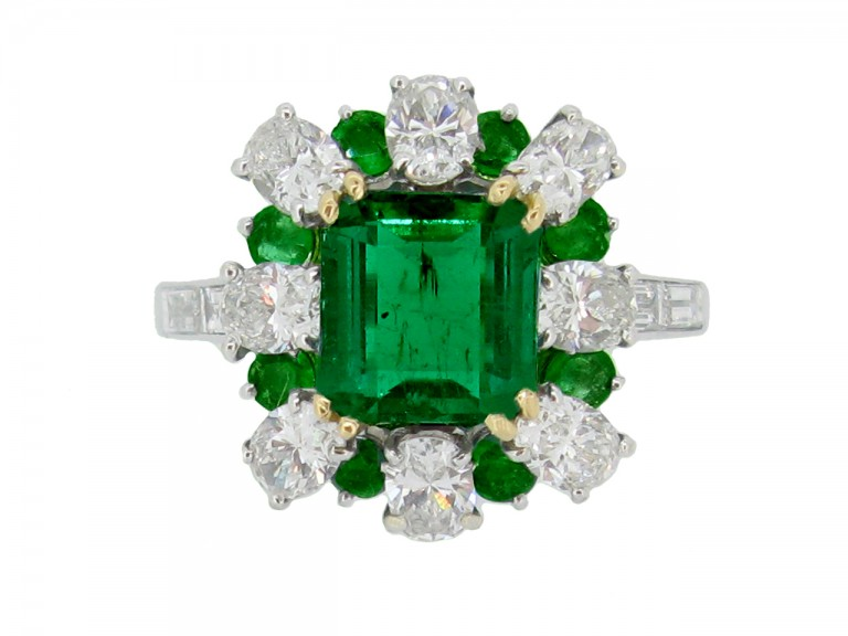front veiw Emerald and diamond cluster ring, French, circa 1960.
