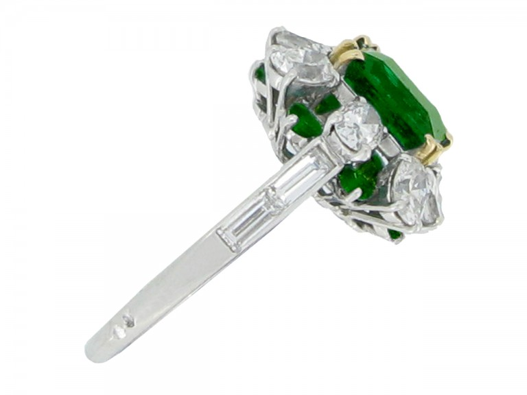 side veiw Emerald and diamond cluster ring, French, circa 1960.