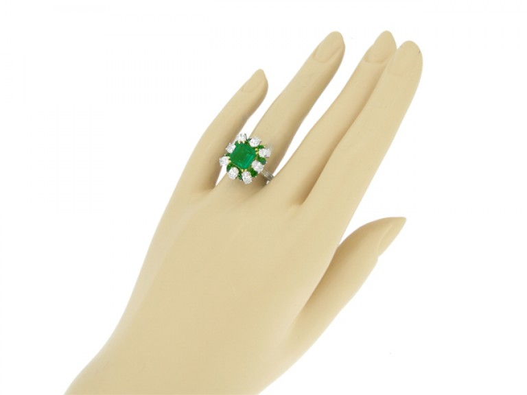 hand view Emerald and diamond cluster ring, French, circa 1960.