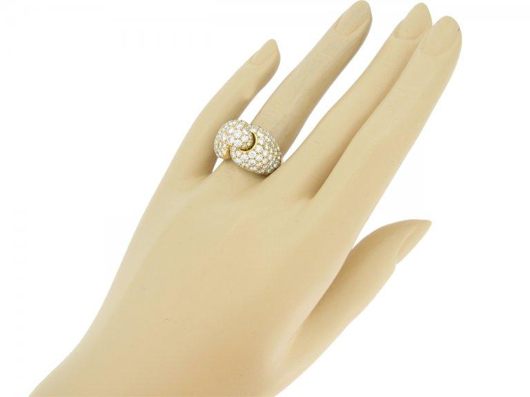hand view Boucheron Paris diamond and yellow gold dress ring, French, circa 1970.