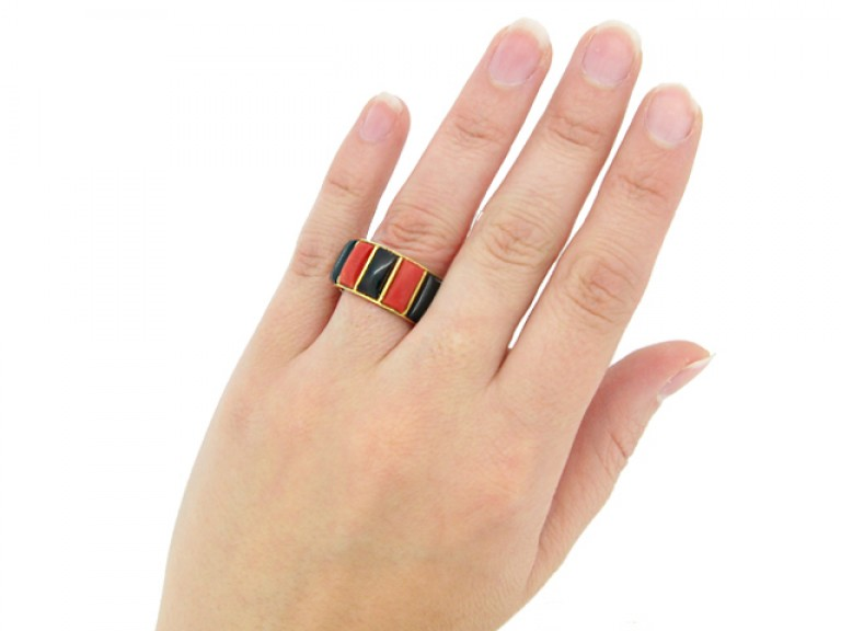 hand view Cartier vintage coral & onyx ring, French, circa 1975.