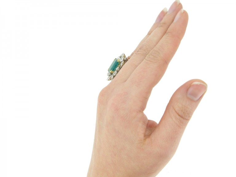 hand view Emerald and diamond cluster ring, French, circa 1950.