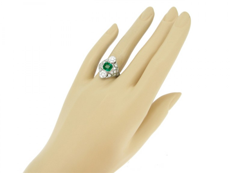 hand view Art Deco emerald and diamond cluster ring, circa 1920.