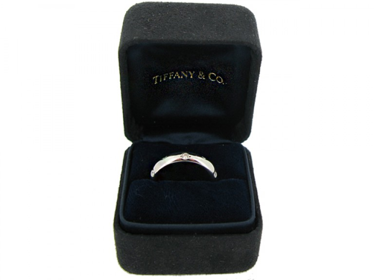 boxed view Tiffany & Co. diamond set band ring, circa 1980.