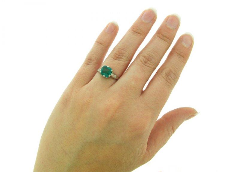 hand view Art Deco emerald and diamond ring, circa 1925.