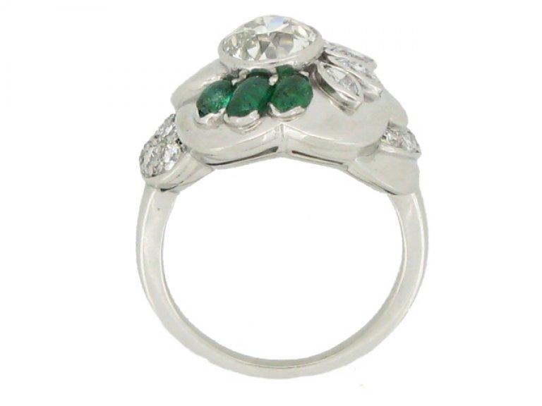 back view Seaman Schepps vintage diamond and emerald flower ring, American circa 1965.