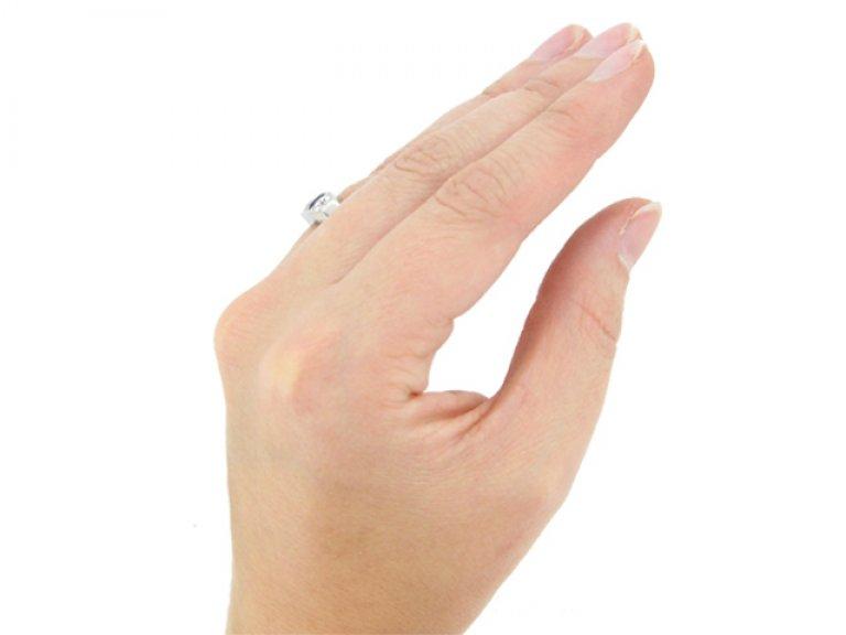 hand view Art Deco sapphire and diamond three stone ring, French, circa 1935.