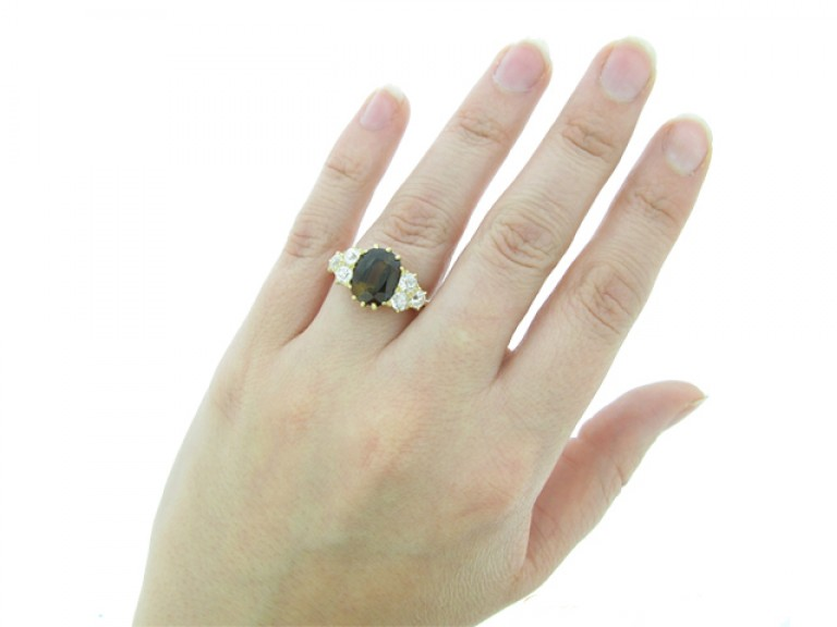 hand view Antique tourmaline and diamond cluster ring, circa 1900.
