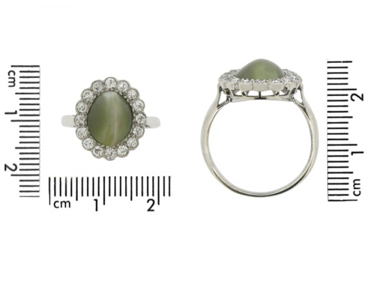 size view Cat's eye chrysoberyl and diamond coronet cluster ring, circa 1910.