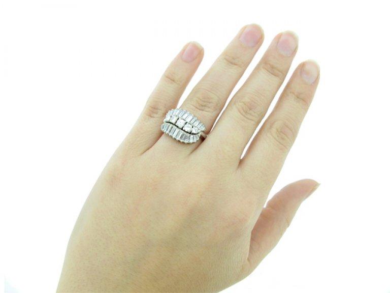 hand view Vintage three row diamond ring, American, circa 1960.
