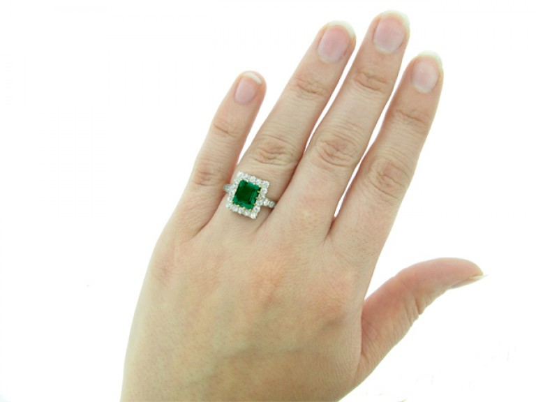 hand view Antique emerald and diamond coronet cluster ring,
