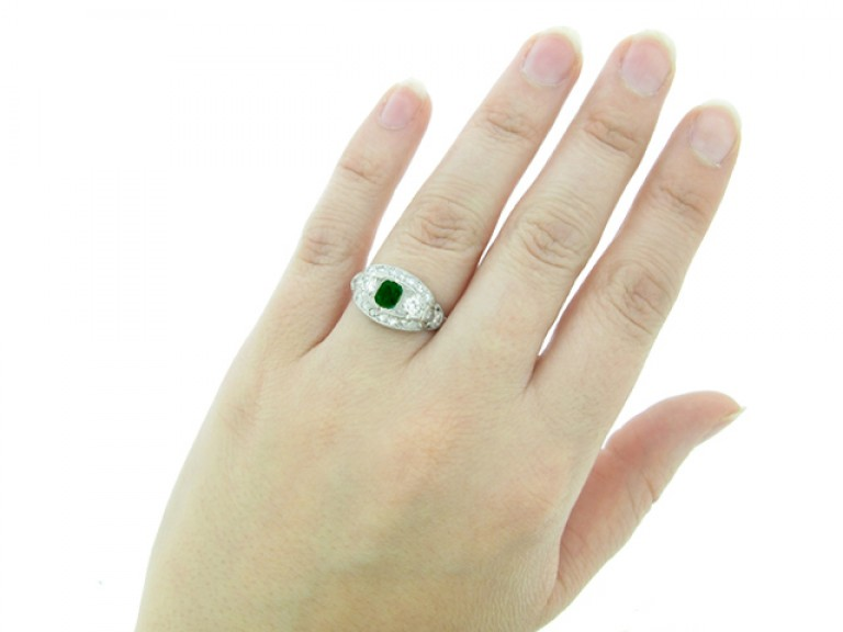 hand view Emerald and diamond cluster ring, American, circa 1950.