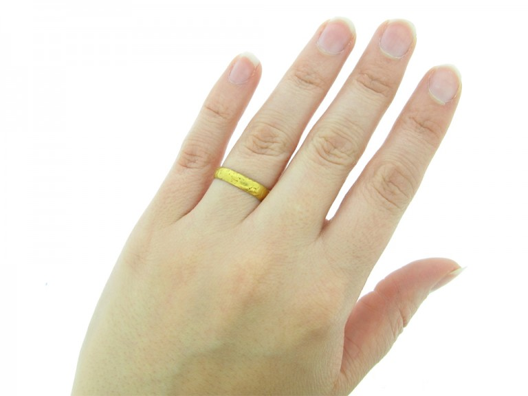 hand view Gold posy ring, 'Content is a continuall tresure',