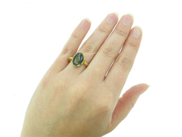 hand view Roman gold ring with minerva intaglio, circa 2nd   3rd century AD.