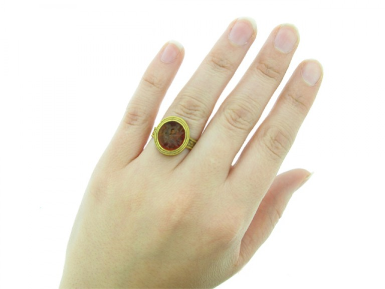 hand view Roman gold finger ring with eagle intaglio, circa 3rd   4th century AD.