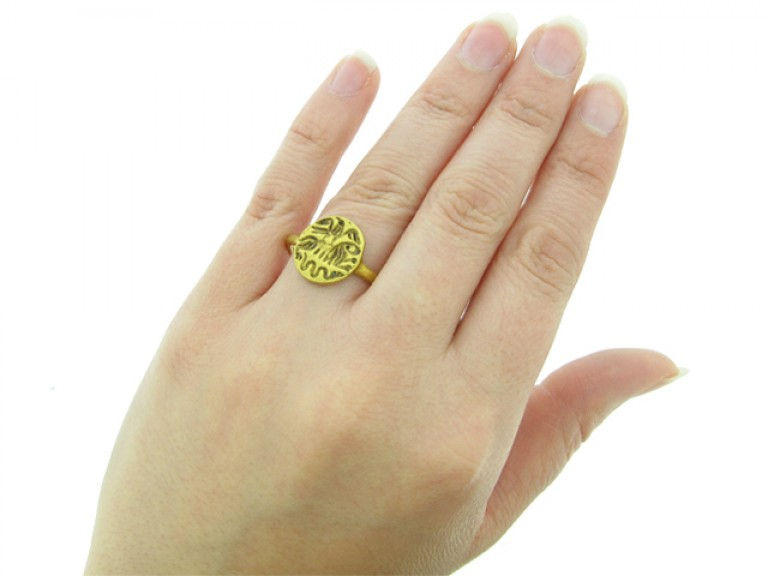 hand view Medieval gold intaglio ring with eagle, lion and serpent