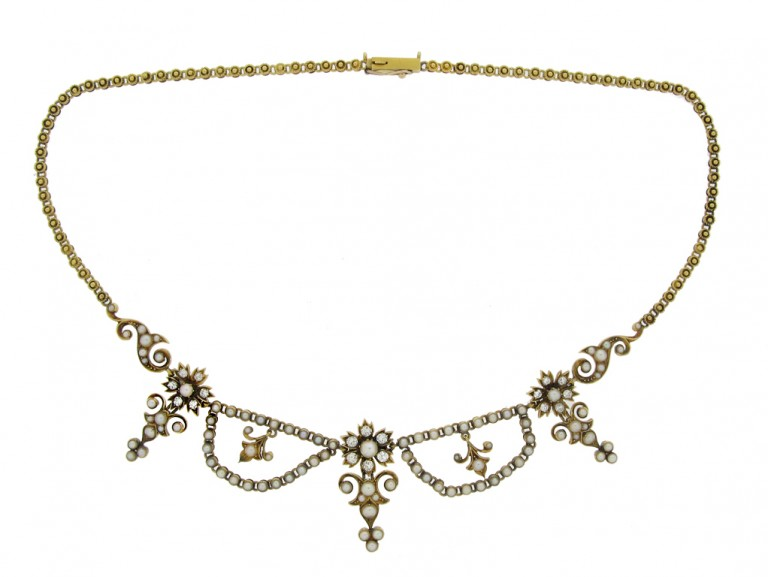 side view Victorian diamond and pearl necklace, circa 1880.