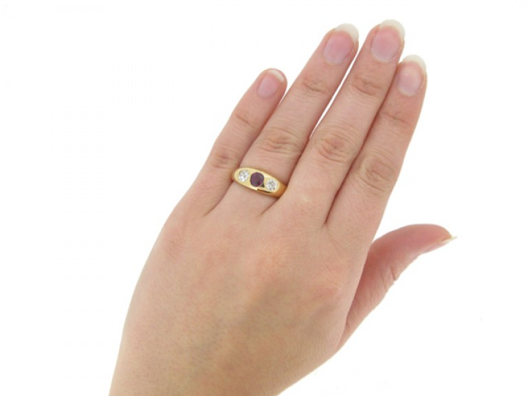 hand view Antique ruby and diamond three stone ring, English, circa 1898.