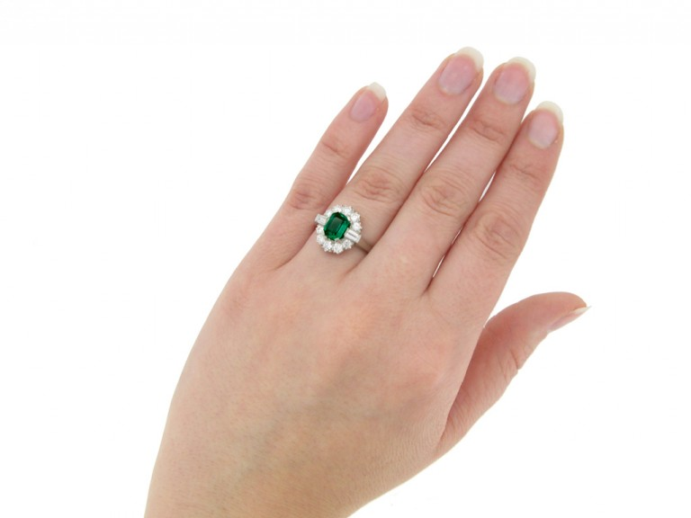 hand view Vintage emerald and diamond coronet cluster ring