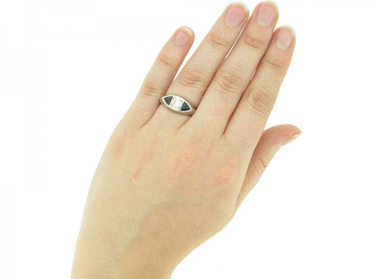 hand view Art Deco sapphire and diamond three stone ring,
