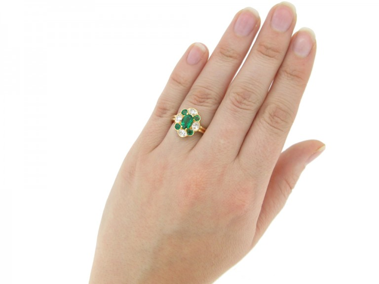 hand view Oscar Heyman Brothers vintage emerald and diamond cluster ring