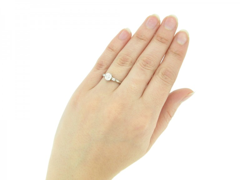 hand view Solitaire old mine diamond ring with baguette shoulders