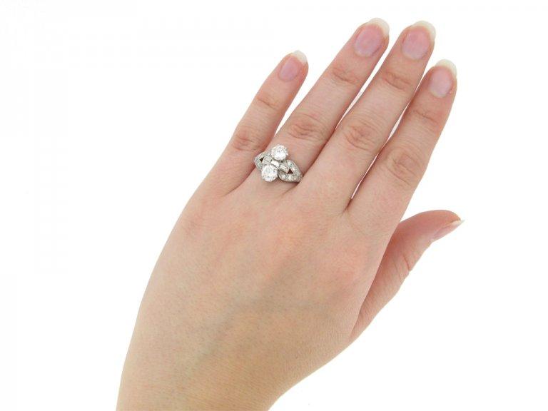 hand view Art Deco two stone diamond cluster ring, circa 1935.