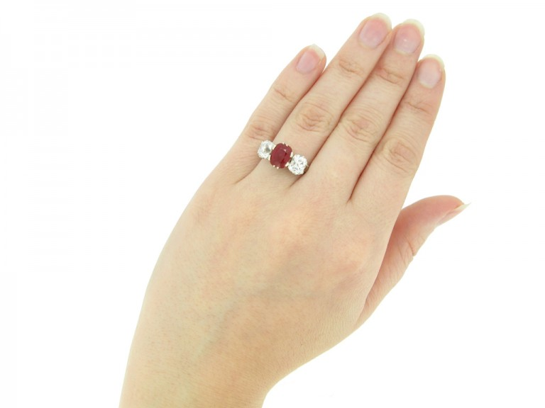 hand view Natural Burmese ruby and diamond three stone ring, circa 1910. berganza hatton garden
