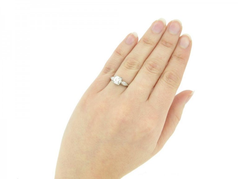 hand view Solitaire diamond ring with marquise diamond set shoulders