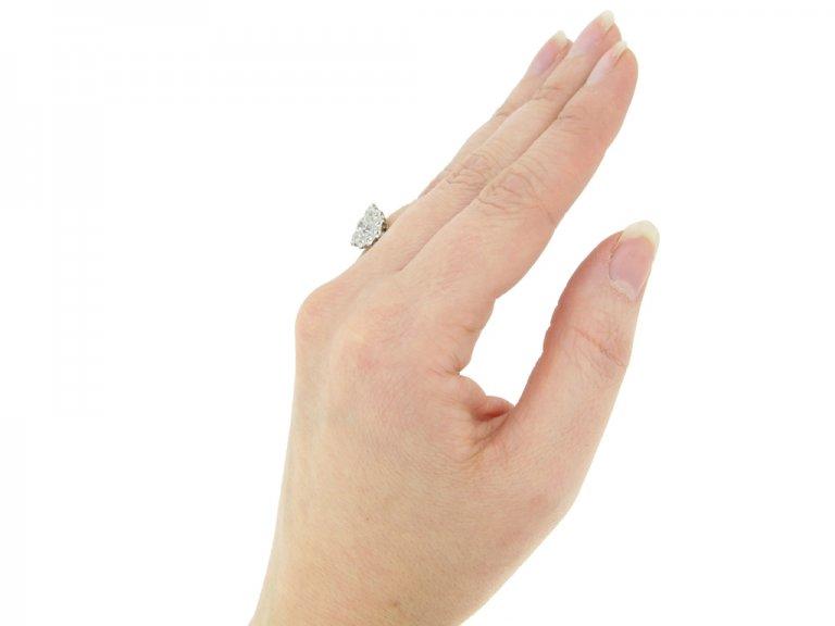 hand view Benedict Bros. diamond triple cluster ring, circa 1920.